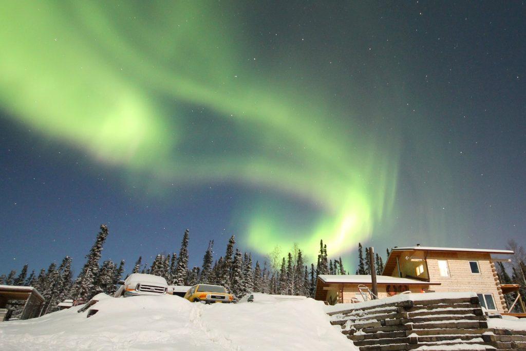 House in Alaska under Aurora Borealis